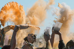 Hands Throw Packets Of Colored Corn Starch At Color Run Royalty Free Stock Photos