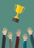 Hands throwing a trophy cup in the air Royalty Free Stock Photo