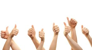 Hands and thumbs up isolated in front of white background stock photography