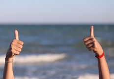 Hands with thumbs up in ok sign. Two hands with thumbs up in ok sign royalty free stock photography