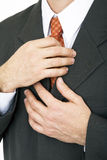 Hands on tie Stock Photo