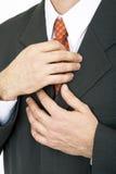 Hands on tie Stock Photo