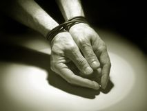 Hands tied. Male hands tied under spotlight Royalty Free Stock Image