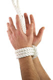 Hands tied. With white rope. Hands isolated in withe background. This is a conceptual image Royalty Free Stock Image