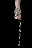 Hands tied chain, kidnapping, dependence, loneliness, social problem, halloween theme, black background. Hands tied chain, kidnapping, social problem, halloween Royalty Free Stock Photo