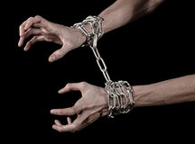 Hands tied chain, kidnapping, dependence, loneliness, social problem, halloween theme, black background. Hands tied chain, kidnapping, social problem, halloween Royalty Free Stock Image