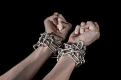 Hands tied chain, kidnapping, dependence, loneliness, social problem, halloween theme, black background Royalty Free Stock Photos