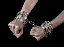 Hands tied chain, kidnapping, dependence, loneliness, social problem, halloween theme, black background. Hands tied chain, kidnapping, social problem, halloween Stock Image