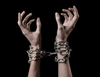 Hands tied chain, kidnapping, dependence, loneliness, social problem, halloween theme, black background. Hands tied chain, kidnapping, social problem, halloween Royalty Free Stock Photography