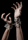 Hands tied chain, kidnapping, dependence, loneliness, social problem, halloween theme, black background. Hands tied chain, kidnapping, social problem, halloween Stock Photo