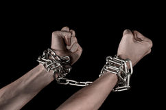 Hands tied chain, kidnapping, dependence, loneliness, social problem, halloween theme, black background. Hands tied chain, kidnapping, social problem, halloween Royalty Free Stock Images