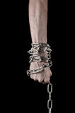 Hands tied chain, kidnapping, dependence, loneliness, social problem, halloween theme, black background Stock Photos