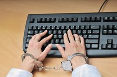 Hands tied with handcuffs on Royalty Free Stock Photos