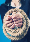Hands tied with rope. Closeup of persons hands tied with strong rope Royalty Free Stock Image