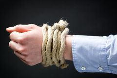 Hands Tied with a Rope Royalty Free Stock Photo