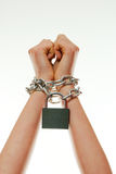 Hands tied up with chains Royalty Free Stock Photography