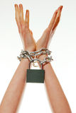 Hands tied up with chains Royalty Free Stock Photos