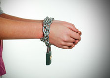 Hands tied up with chains Stock Images