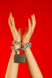 Hands tied up with chains Stock Photography