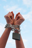 Hands tied up with chains Royalty Free Stock Image