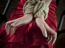 Hands tied up with rope stock images