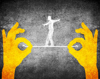Hands and tightrope walker. Orange hands and tightrope walker Royalty Free Stock Photo
