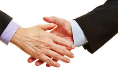 Hands about to giving shakehands Stock Photography