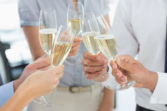 Hands toasting with champagne. Extreme closeup hands toasting with champagne Royalty Free Stock Photos