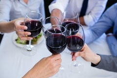 Hands toasting wine glasses Royalty Free Stock Photos