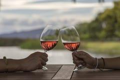 Hands toasting wine Stock Photos