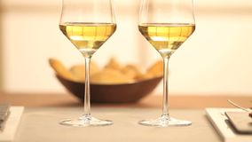 Hands toasting with wine. Hands toasting with white wine stock video footage