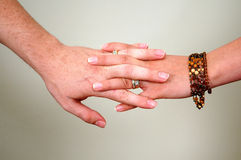 Hands together. A woman and man holding hands royalty free stock photo