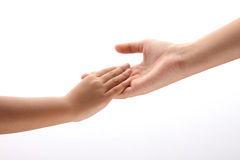 Hands together. Elder hand embrace youth hand, joint together with lite background Royalty Free Stock Photo