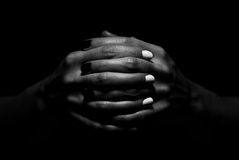 Hands Together. Photo of two hands together, on black background. Nails are painted in black and white color, symbolising yin yang. Her hands and fingers are Royalty Free Stock Photography