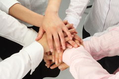 Hands together - dynamic business team Stock Photo