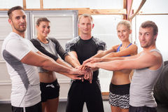 Hands together - fitness team in a gym Royalty Free Stock Images