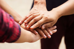 Hands together. Group of people put their hands together Stock Photo