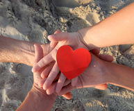 Hands together holding heart Royalty Free Stock Photography