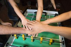 Hands together over football table. Stock Images
