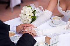 Hands together on a table stock images