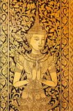 Hands together of Thai princess on old fresco of a Buddhist temple Royalty Free Stock Photo
