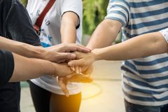 Hands together for unity and share success stock photo