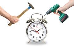 Hands with tool break the alarm clock Royalty Free Stock Photos