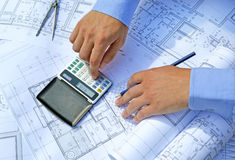 Hands with tool and project drawings Royalty Free Stock Photos
