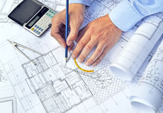 Hands with tool and project drawings Stock Photos