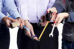 Hands with tools Royalty Free Stock Image