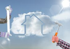 Hands with tools in the sky with house cloud. Digital composite of hands with tools in the sky with house cloud Royalty Free Stock Images