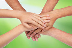 Hands on top of each other green Stock Images