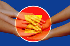 Hands on top with icon of Asean Economic Community Royalty Free Stock Photos