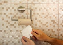 Hands with torn toilet paper. At the end stock images